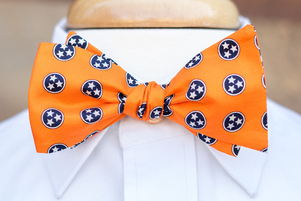 Volunteer Traditions Orange Bowtie featuring Navy Tristars on neck.