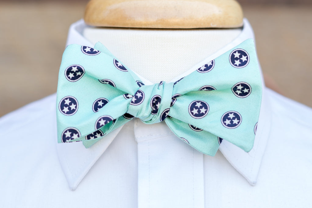 Volunteer Traditions Mint Bowtie featuring Navy Tristars on neck.