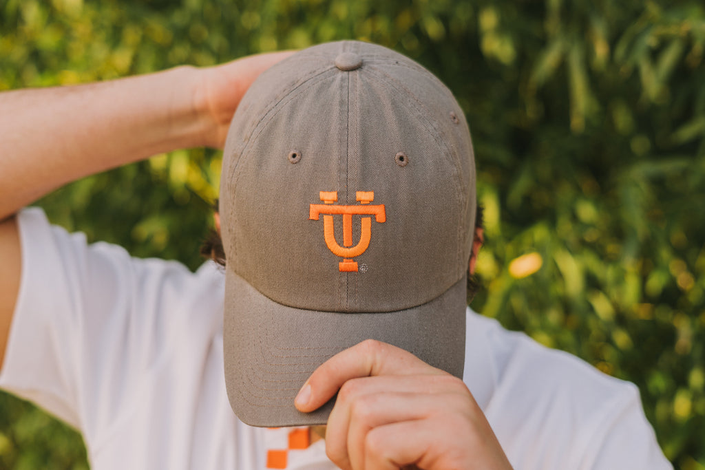 Volunteer Traditions Interlocking UT University of Tennessee Licensed Hat in Grey on head.