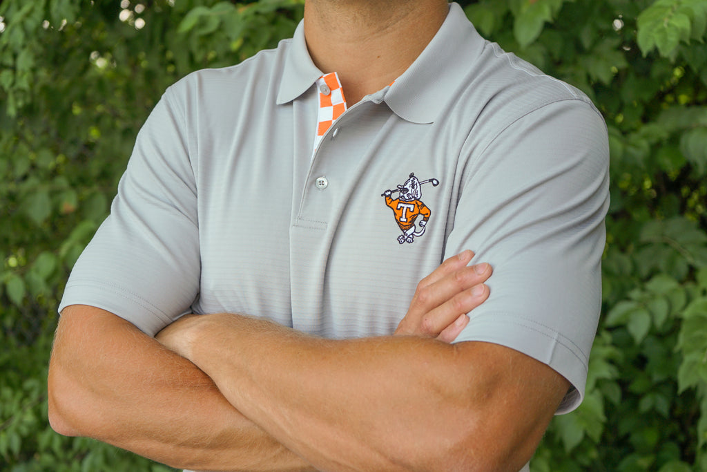 Volunteer Traditions University of Tennessee Grey Golfin' Smokey Polo Featuring a Checkerboard Placket from front.