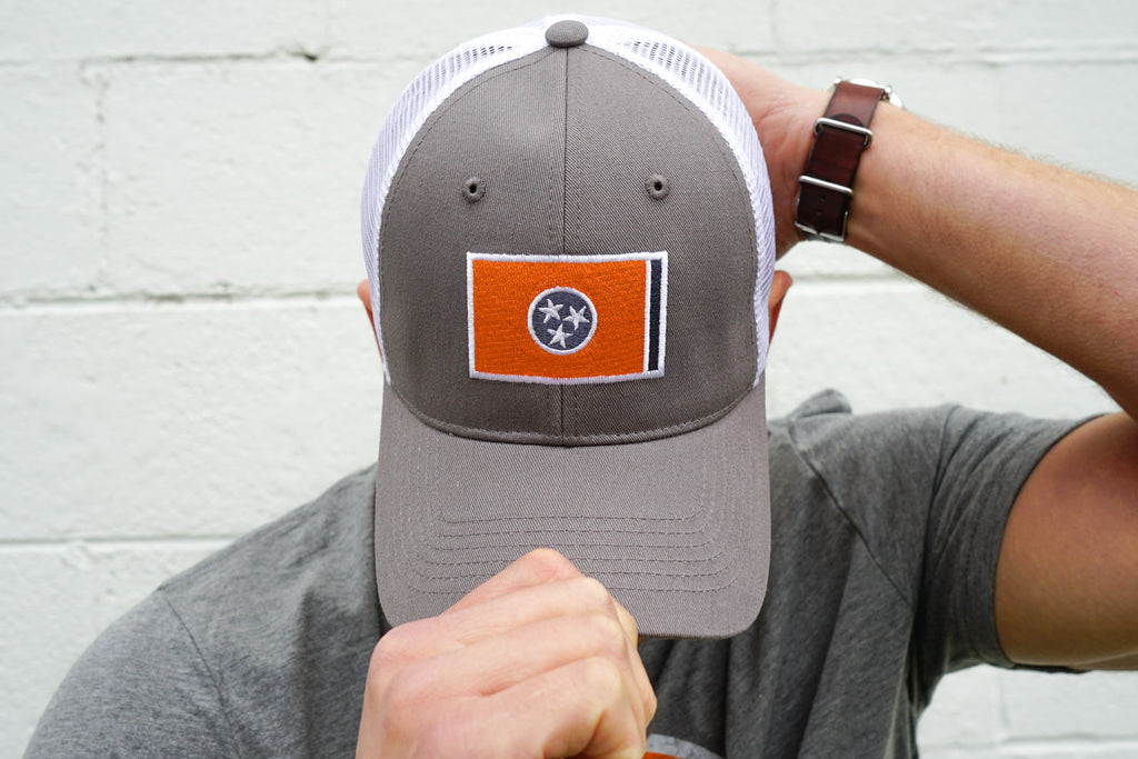 Volunteer Traditions Grey with Orange Tennessee Flag Promesh Hat on head.