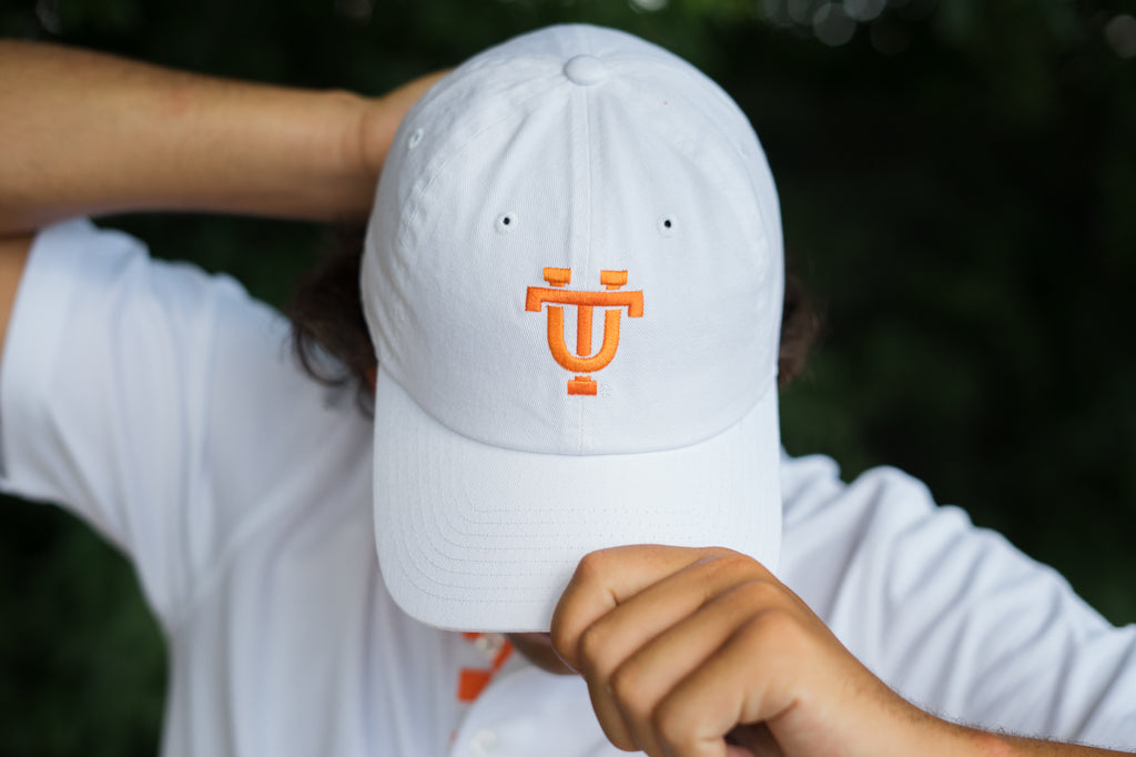 Volunteer Traditions Interlocking UT University of Tennessee Licensed Hat in White on head.