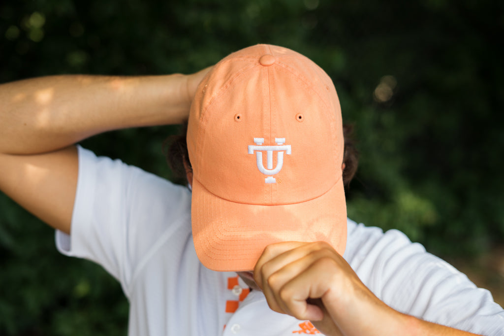 Volunteer Traditions Interlocking UT University of Tennessee Licensed Hat in Orange Peel on head.