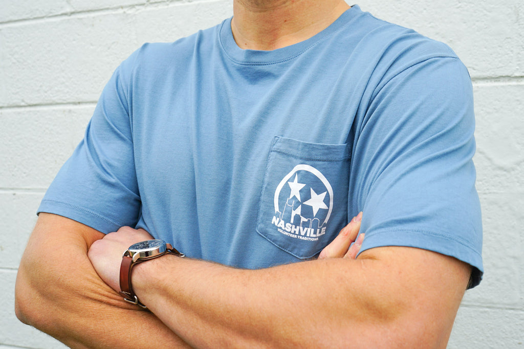 Volunteer Traditions Stone Blue Nashville Short Sleeve Pocket Tee from the front.