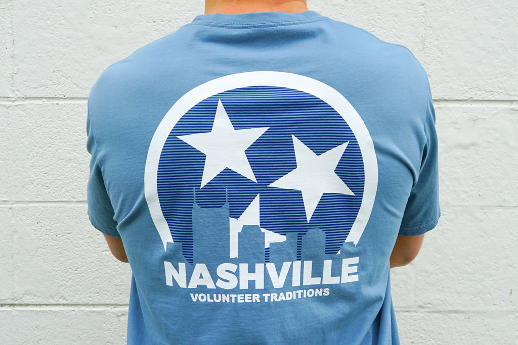 Volunteer Traditions Stone Blue Nashville Short Sleeve Pocket Tee from the back.