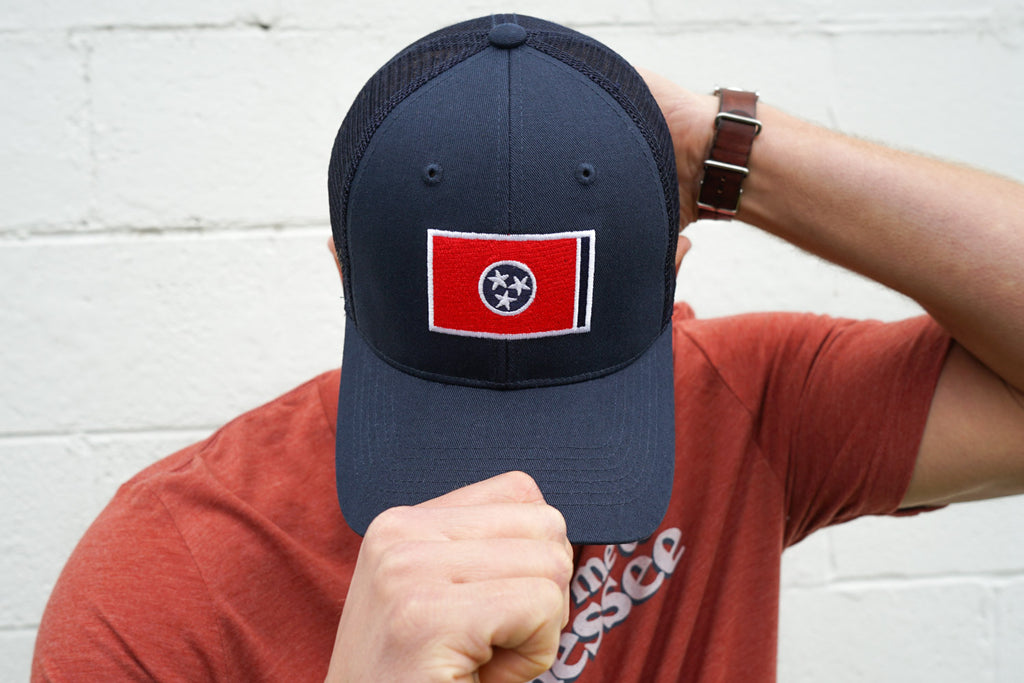 Volunteer Traditions Navy with Red Tennessee Flag Promesh Hat on head.