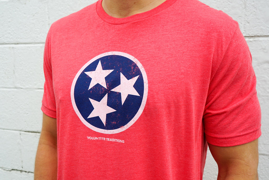 Volunteer Traditions Heather Red with Navy Tristar Heather Triblend Tee from front.