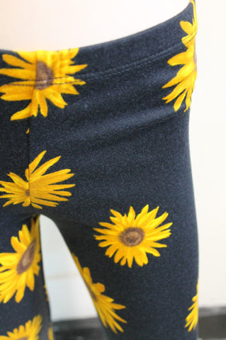 KIDS yellow daisy girls leggings on black children - Carrie's Closet