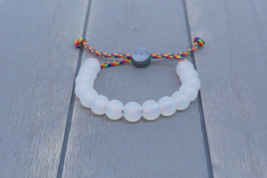 translucent adjustable silicone bead bracelet on rainbow paracord