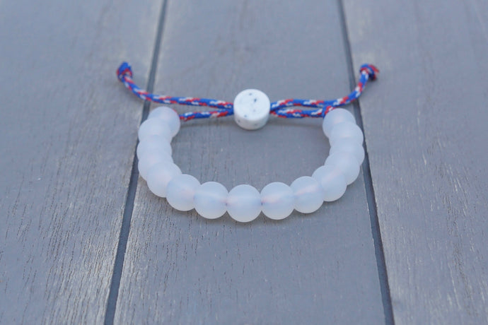 translucent  adjustable silicone bead bracelet on blue, white and red paracord