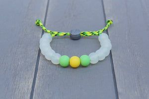 translucent  adjustable silicone bead bracelet on yellow and green paracord