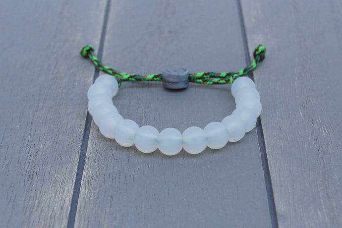 Translucent adjustable silicone bead bracelet with multi-green paracord