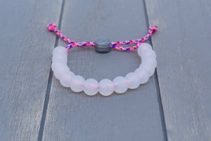 translucent  adjustable silicone bead bracelet on pink and purple paracord