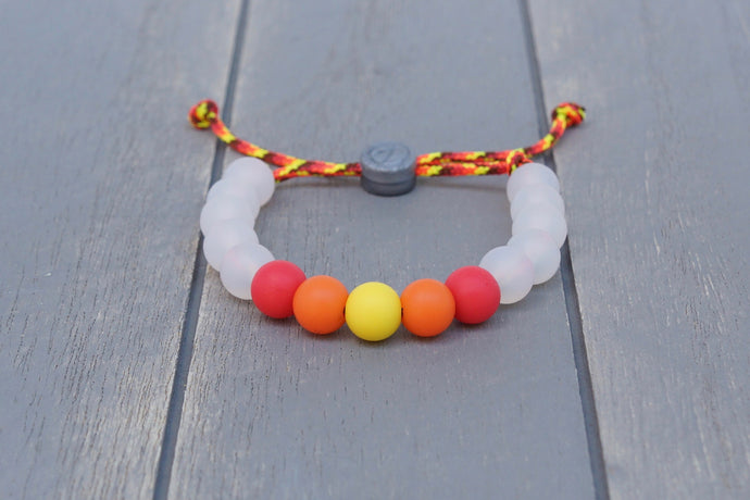 Translucent adjustable silicone bead bracelet on fire coloured paracord