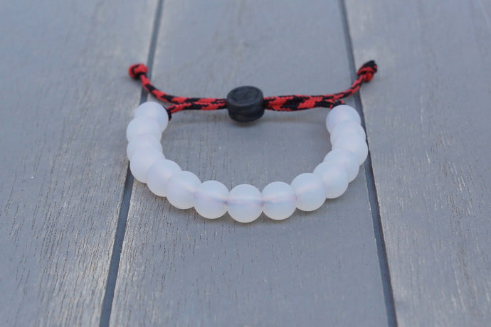 Translucent adjustable silicone bead bracelet on black and red paracord