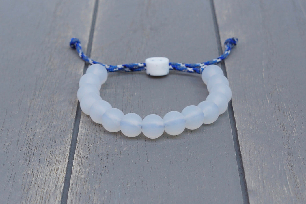 Translucent adjustable silicone bead bracelet on blue camo paracord