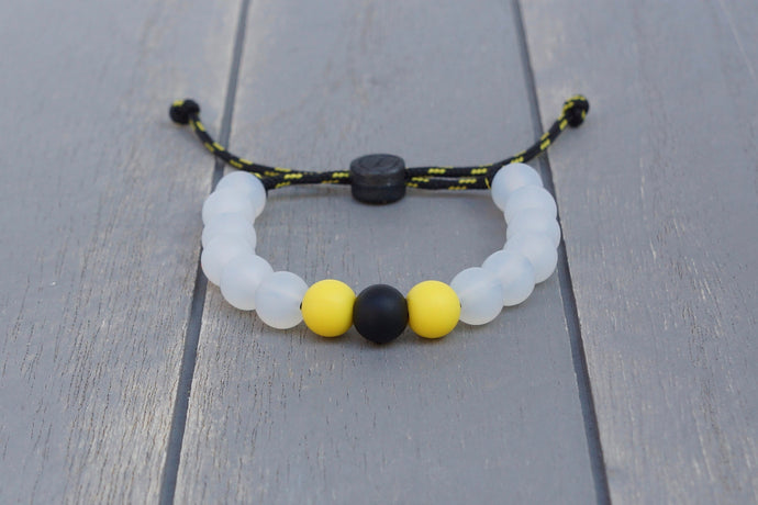 Translucent adjustable silicone bead bracelet on black and yellow paracord