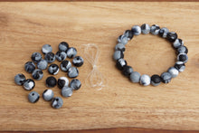 Load image into Gallery viewer, black and grey tie-dye silicone bead bracelet kit