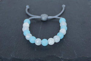 Translucent and metallic white and blue adjustable silicone bead bracelet