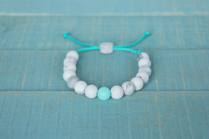 marble with turquoise accent bead adjustable silicone  bracelet