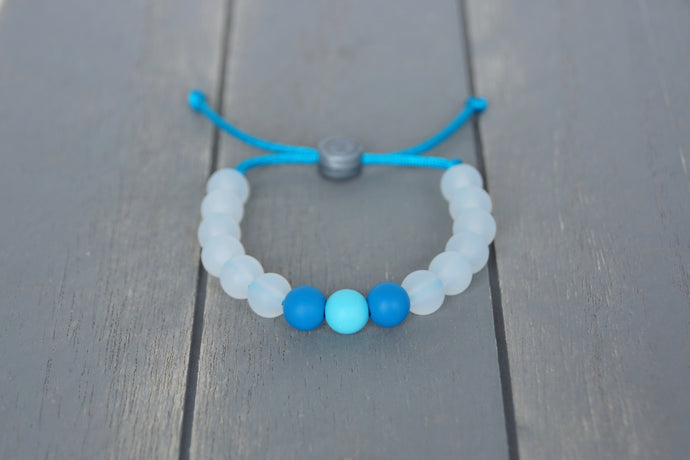 translucent adjustable silicone bead bracelet with blue accent beads on blue nylon cord