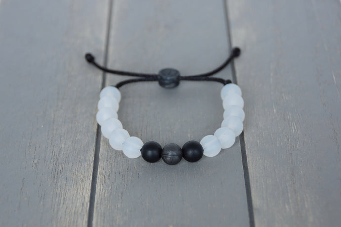 Translucent adjustable silicone bracelet with black accent beads on black nylon cord