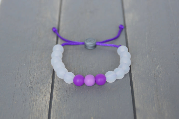 translucent  adjustable silicone bead bracelet with purple accent beads