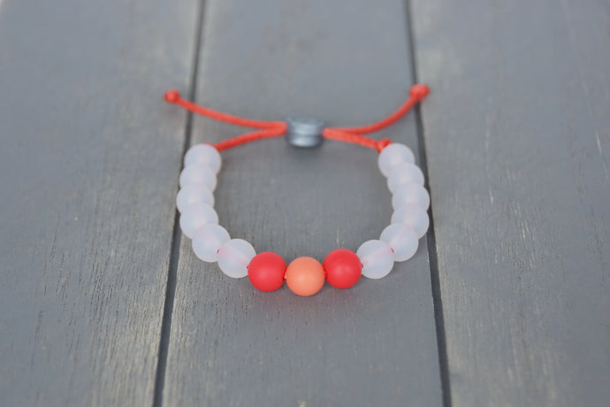 Translucent adjustable silicone bead bracelet with orange accents
