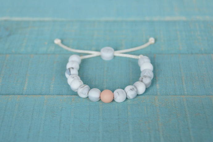 white marble and peach accent bead adjustable silicone bracelet