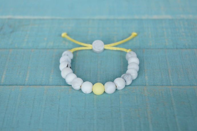 White Marble with yellow accent bead adjustable silicone bracelet