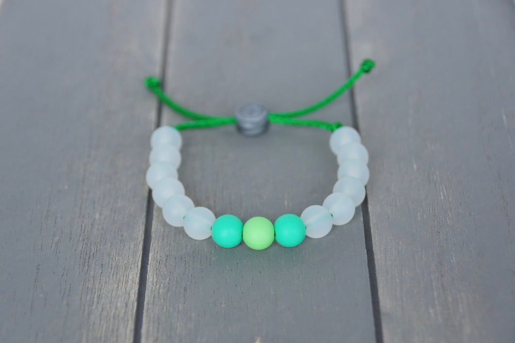 translucent adjustable silicone bead bracelet on green nylon