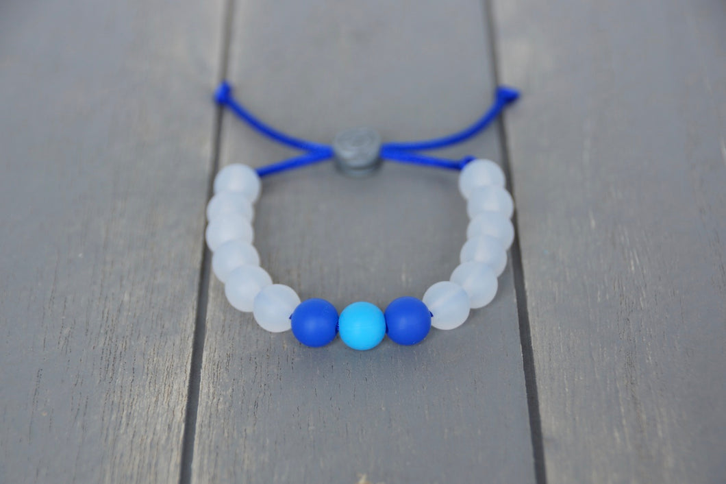Translucent adjustable silicone bracelet with blue accent beads on blue nylon cord