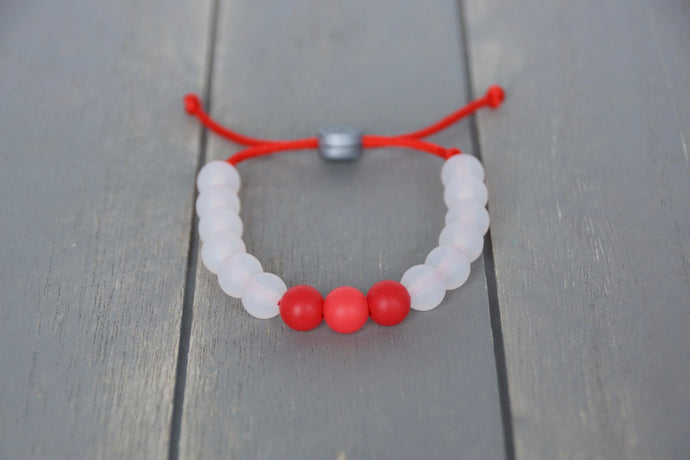 translucent adjustable silicone bracelet with red accent beads and cord