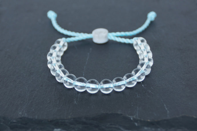 Clear glass adjustable bracelet on twisted light blue nylon cord