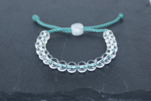 Clear glass adjustable bracelet on twisted sea green nylon cord