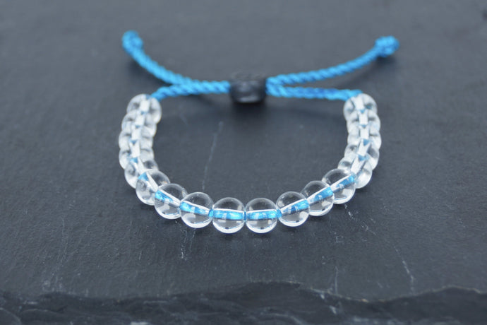 Clear glass adjustable bracelet on twisted blue nylon cord