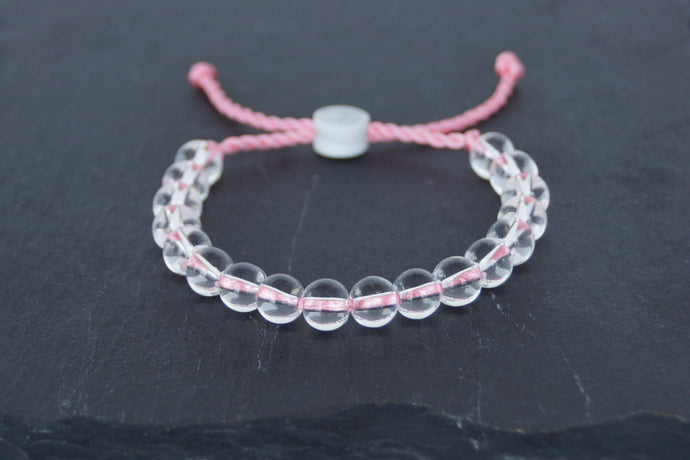Clear glass adjustable bracelet on twisted light pink nylon cord