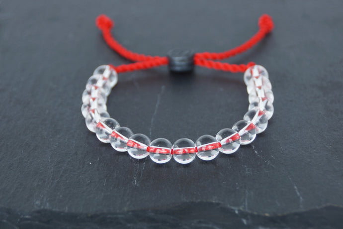 Clear glass adjustable bracelet on twisted red nylon cord