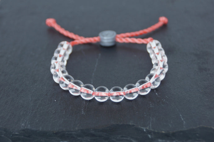 Clear glass adjustable bracelet on twisted coral pink nylon cord