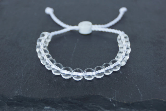 Clear glass adjustable bracelet on twisted white nylon cord