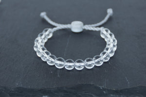 Clear glass adjustable bracelet on twisted grey nylon cord