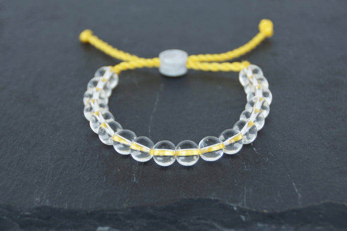 Clear glass adjustable bracelet on twisted yellow nylon cord