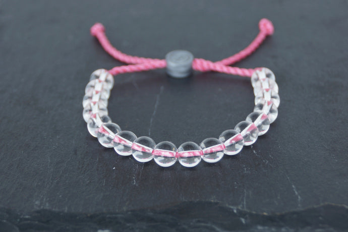 Clear glass adjustable bracelet on twisted pink nylon cord