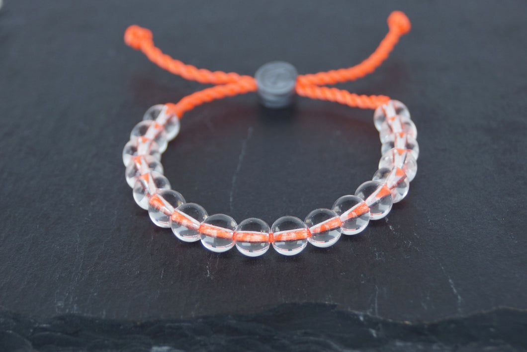Clear glass adjustable bracelet on twisted orange nylon cord