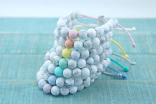 Load image into Gallery viewer, White marble with pastel accent bead adjustable silicone bracelets