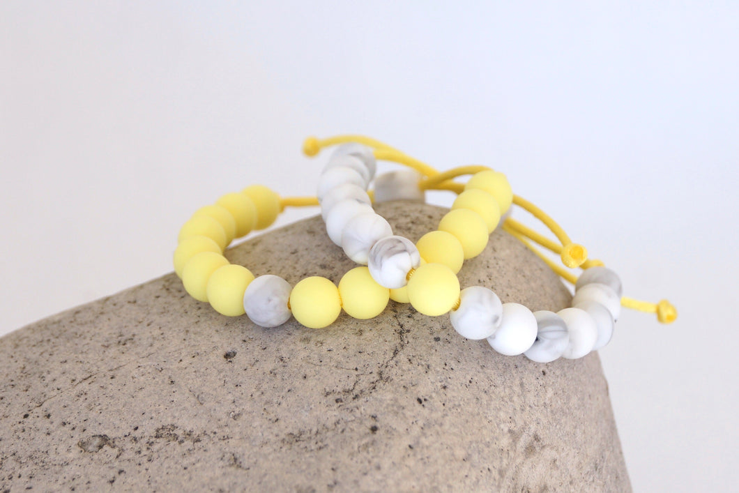 Set of 2 white marble and yellow adjustable silicone bead bracelets