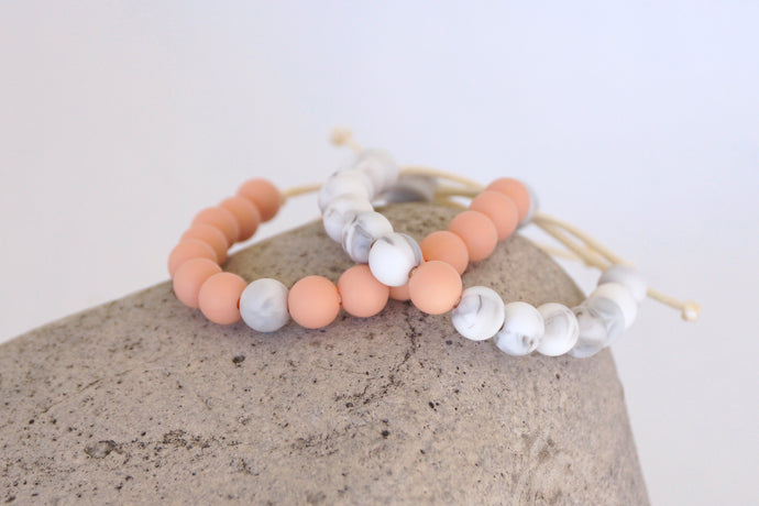 set of 2 peach and white marble adjustable silicone bead bracelets