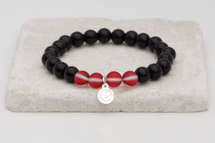 Black glass with red moonstone bracelet on elastic