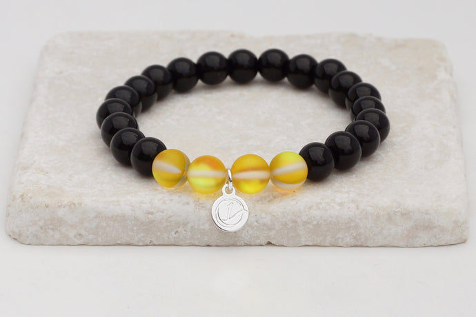Black glass with yellow moonstone bracelet on elastic