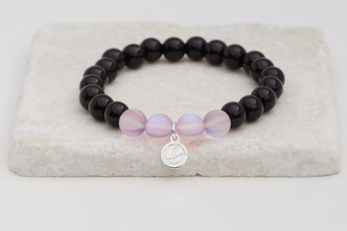 Black glass with light purple moonstone bracelet on elastic